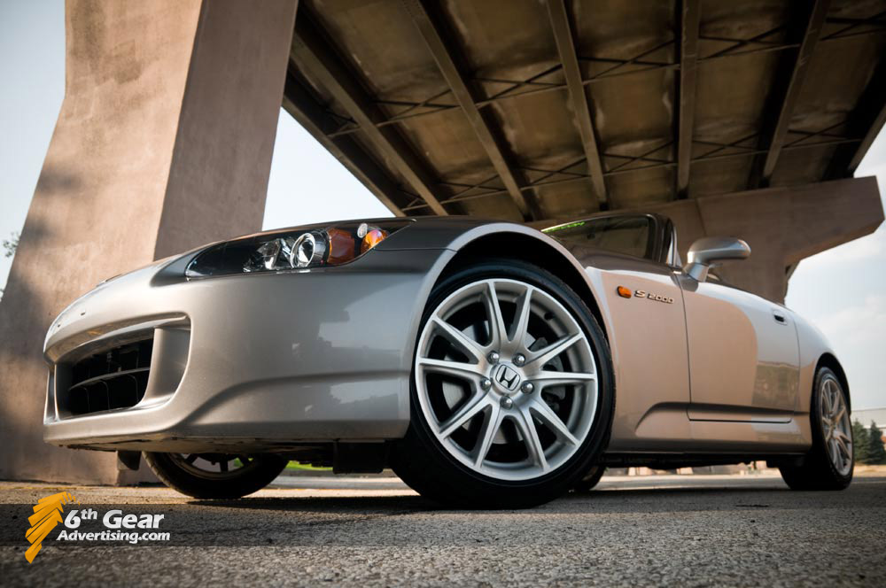 Honda S2000 AP2 shot under a bridge.