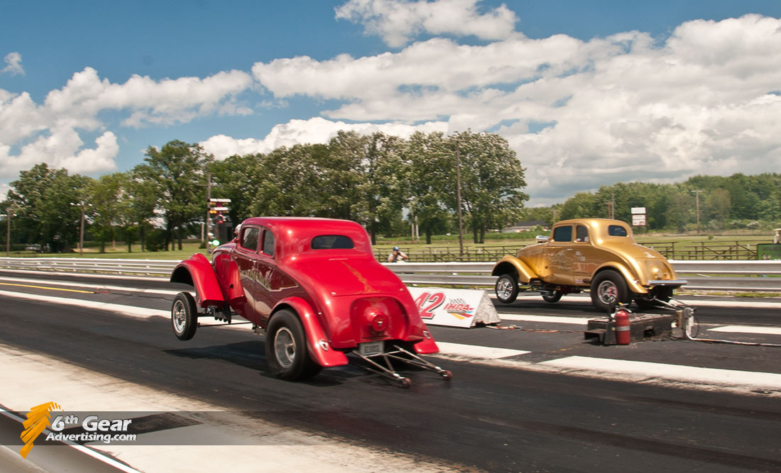 Pair of Gassers drag racing at Rock and Race