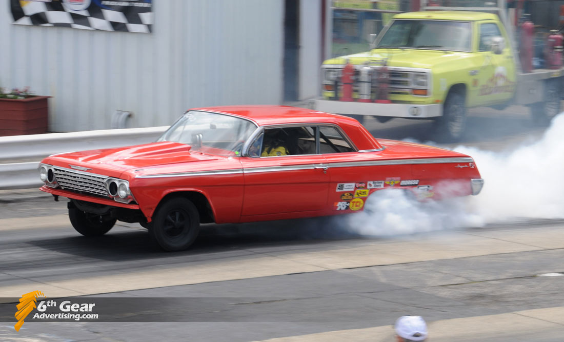 1962 Chevrolet Impala doing a smokey burnout at Dragway 42's Rock and Race event.